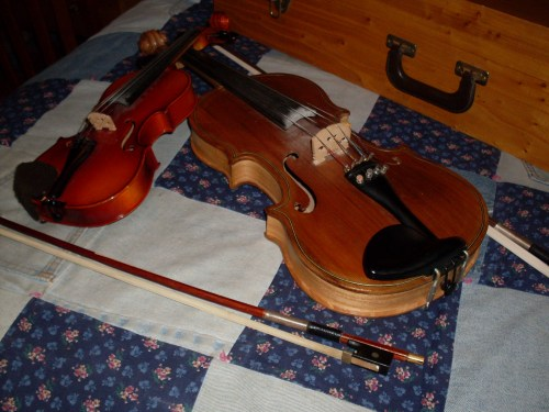 My elmwood and fir fiddle, which my dad made - and my son's 1/10th size violin.
