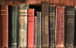 Old Tattered Books on a Shelf