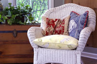 Wicker Chair White, with Red and Blue Pillows